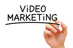 Video Marketing. Hand writing Video Marketing with black marker on transparent wipe board Stock Photo