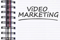 Video marketing words on spring note book Stock Photos