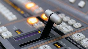 Video mixer control. Close up of video mixer control panel at tv broadcasting studio. Selective focus royalty free stock photography