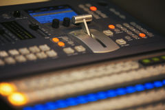 Video mixing control table at tv studio Stock Photography