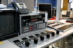 Video mixing desk. Video control mixing desk used for television news broadcasting stock photography