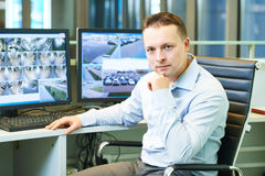 Video monitoring surveillance security system. Security guard officer watching video monitoring surveillance security system royalty free stock image