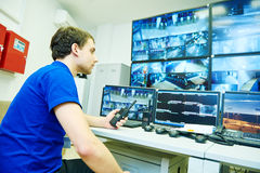 Video monitoring surveillance security system. Security guard officer watching video monitoring surveillance security system Stock Image