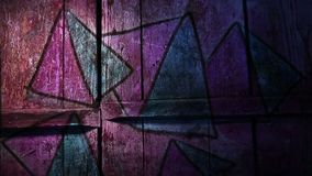 Video motion graffiti pyramid, triangle ornament. Video motion  graffiti pyramid, triangle ornament night light moves along the wall abstract background  pattern stock footage