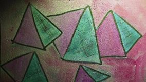Video motion  graffiti  pyramid, triangle ornament. Video motion  graffiti   pyramid, triangle ornament night light moves along the wall abstract background stock video footage