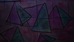 Video motion  graffiti   pyramid, triangle. Video motion  graffiti    pyramid, triangle ornament night light moves along the wall abstract background  pattern hd stock video