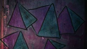 Video motion  graffiti    pyramid, triangle. Video motion  graffiti     pyramid, triangle ornament night light moves along the wall abstract background  pattern stock footage