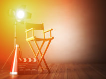 Video, movie, cinema concept.  Clapperboard and director chair. Stock Photo