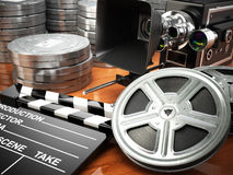 Video, movie, cinema vintage concept. Retro camera, reels and cl. Apperboard. 3d Stock Image