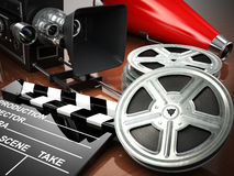 Video, movie, cinema vintage concept. Retro camera, reels and cl. Apperboard. 3d Royalty Free Stock Photo