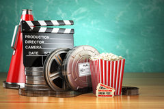 Video, movie, cinema vintage production concept. Film reels, cla. Pperboard, tickets, popcorn and megaphone. 3d Stock Images
