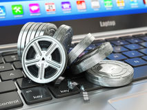 Video or movie online internet concept. Film reels on laptop key. Board. 3d Stock Photography