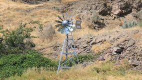 Video of moving windmill aerator structure in high desert in central Oregon 1080p stock video