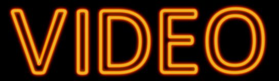Video neon sign. Abstract 3d rendered words video orange neon sign on black background Royalty Free Stock Images