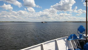 Video from the nose of the ship. River landscape, summer, clouds. Volga cruise, Russia.  stock video footage