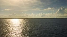 Video ocean sky horizon small boat sailing in setting sun light stock video footage