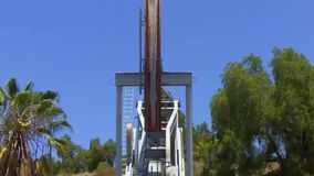 Oil well pump jack extracting petroleum stock footage