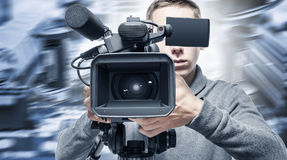 Video operator records the video. Video operator records the video on the unbranded video camera Stock Images
