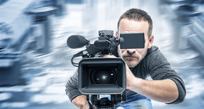 Video operator records the video. Video operator records the video on the unbranded video camera Royalty Free Stock Photo