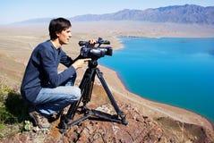 Video operator removes desert lake stock photography