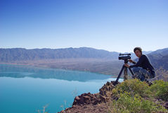 Video operator removes desert lake Royalty Free Stock Photos