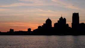 A panning shot across downtown Detroit at dusk stock video footage