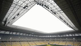 5 in 1 video. A panorama of the stadium with a lightweight lawn mower system. Wide plan.