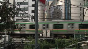 Passenger train passing through a built up suburb. Video of passenger train passing through a built up suburb stock video
