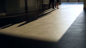 Video Pedestrian commuters long shadows of people walking at train station in the city stock video