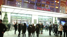 Video of people coming in and out from the large decorated shopping center Palladium in Prague stock video