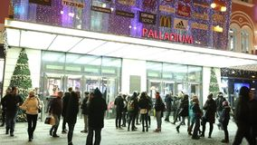 Video of people coming in and out from the large decorated shopping center Palladium in Prague stock footage