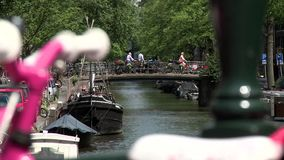 Pink and white bike to the Bloemgracht canal in Amsterdam. Video of pink and white bike to the Bloemgracht canal in Amsterdam stock video footage