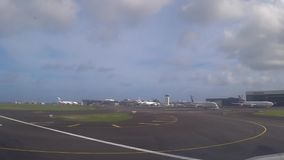 Moving on runway. Video of plane moving on runway on cloudy day stock video