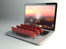 Video player app or home cinema concept. Laptop and rows of cine Stock Image