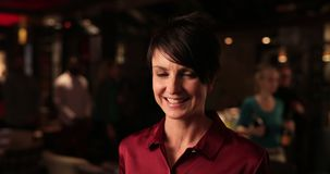 Happy Mid Adult Woman. Video portrait of a mid adult woman looking at the camera and smiling stock video