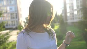 Video portrait young beautiful teenage girl smiling walking on the city street. HD stock video footage