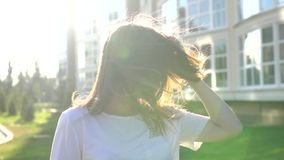Video portrait young beautiful teenage girl smiling walking on the city street stock video footage