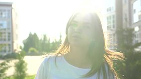 Video portrait young beautiful teenage girl smiling walking on the city street stock video