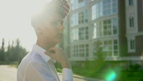 Video portrait of young teenage boy outdoor on the city street slow motion stock video footage