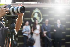 Video DSLR Camera social network live recording on interview session of contest. Video Production Camera social network live recording on Stage event which has stock photography