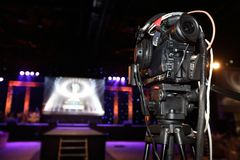 Video Production Camera social network live recording on Stage. Event which has interview session of contest, performance, concert or business seminar.  World Royalty Free Stock Images