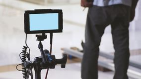 Video production monitor in tv commercial shooting. Behind the scenes of film or video production monitor in tv commercial shooting and movie crew team setting stock photo