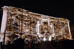 Video projection transforms museum facade at Bucharest Spotlight Royalty Free Stock Images