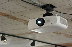 Video projector. Hanged on the celling Stock Photos