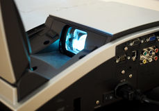 Video projector lens. Light from a digital video projector lens royalty free stock photos