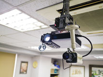 Video projector. For work presentation or home cinema entertainment on ceiling stock image