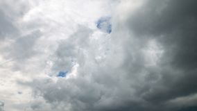 Video of rainy clouds on blue sky. Video of white clouds on blue sky in the summer stock footage
