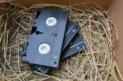 Video recorder cassette on straw Stock Photography