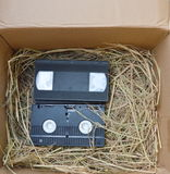 Video recorder cassette on straw Stock Image