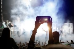 Video recording of the music show by smartphone royalty free stock photos